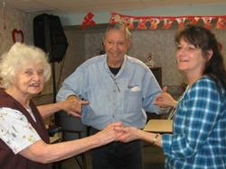 Staff and elderly clients at a social gathering