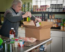 Volunteer stocking a food pantry